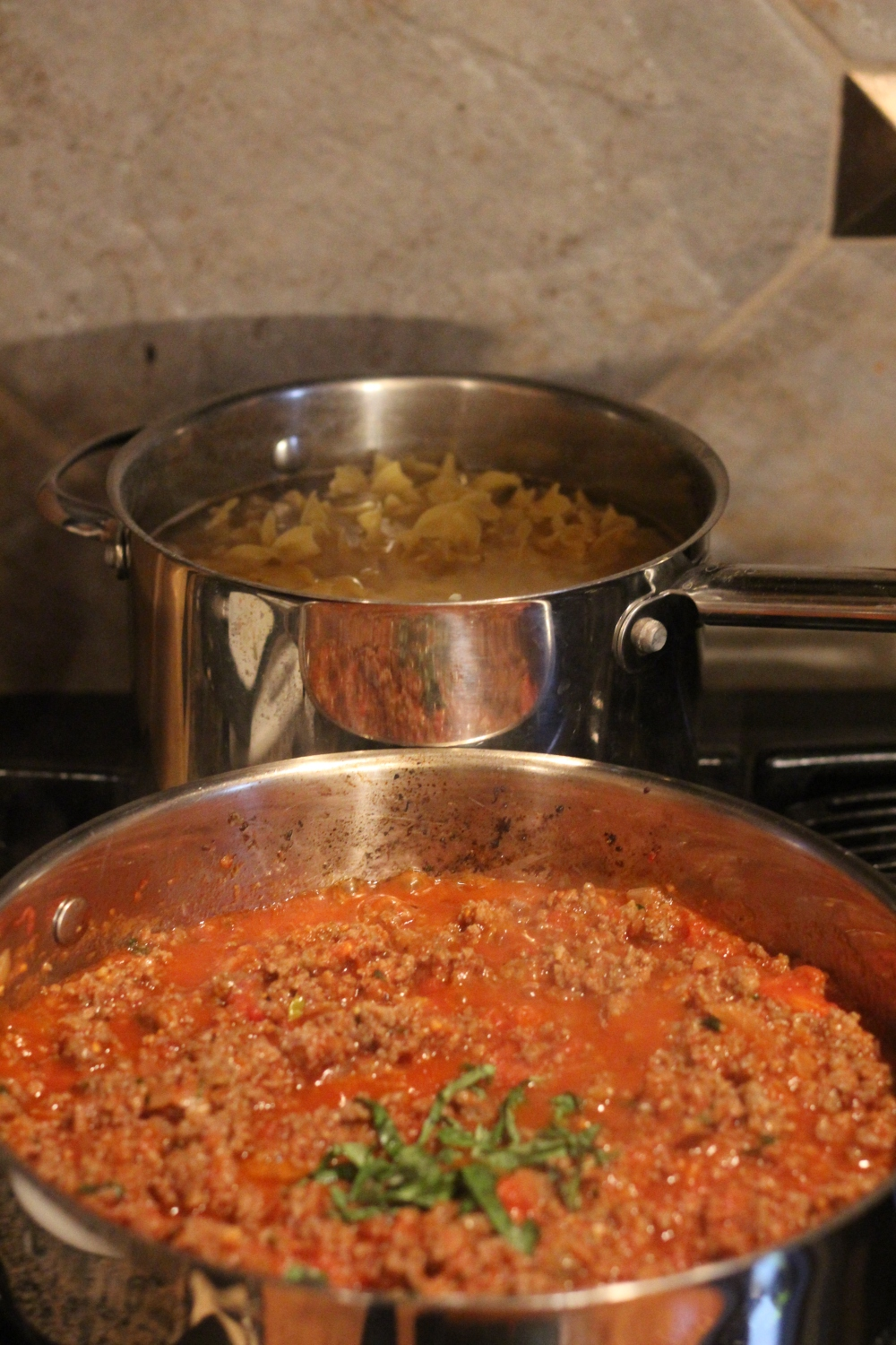 Noodles Boiling, Meat & Tomatoes Simmering.